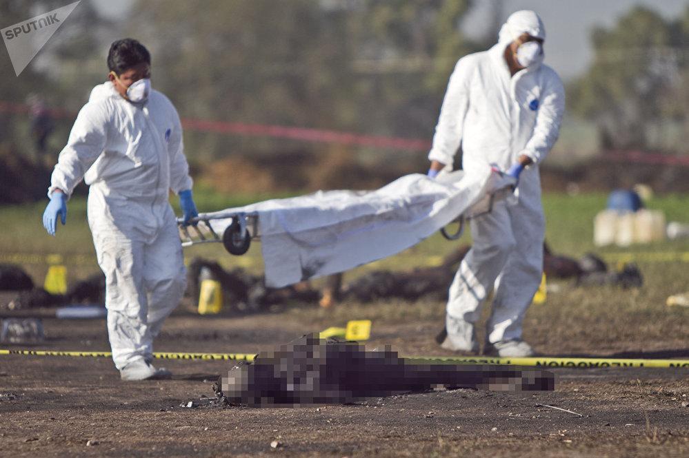 Corps calcinés suite à l'explosion de l'oléoduc de Pemex