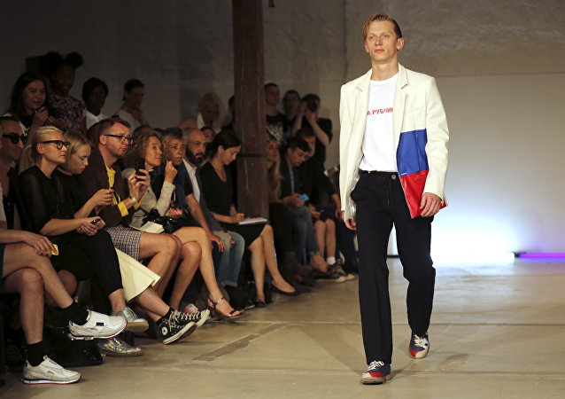 A model wears a creation for Gosha Rubchinskiy's Men's spring-summer 2015 fashion collection presented in Paris, France, Wednesday, June 25, 2014