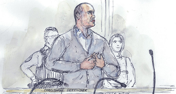 This court sketch made on February 13, 2019 shows Christophe Dettinger, a former boxer, standing during the opening hearing of his trial over the assault of a police officer during 'yellow vest' protest (gilets jaunes), at the Paris courthouse.