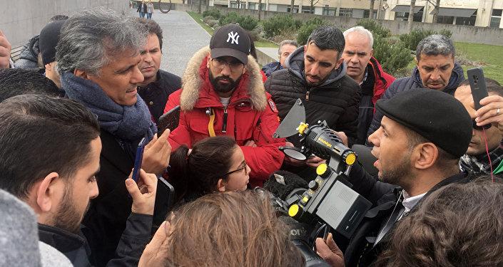 Presidential candidate Nekkaz talks with media outside the HUG in Geneva