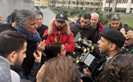 Presidential candidate Nekkaz talks with media outside the HUG in Geneva