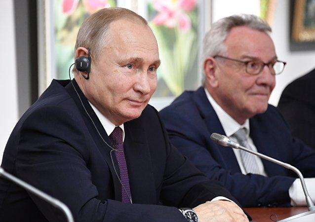 Vladimir Poutine lors d'une rencontre avec Thierry Mariani