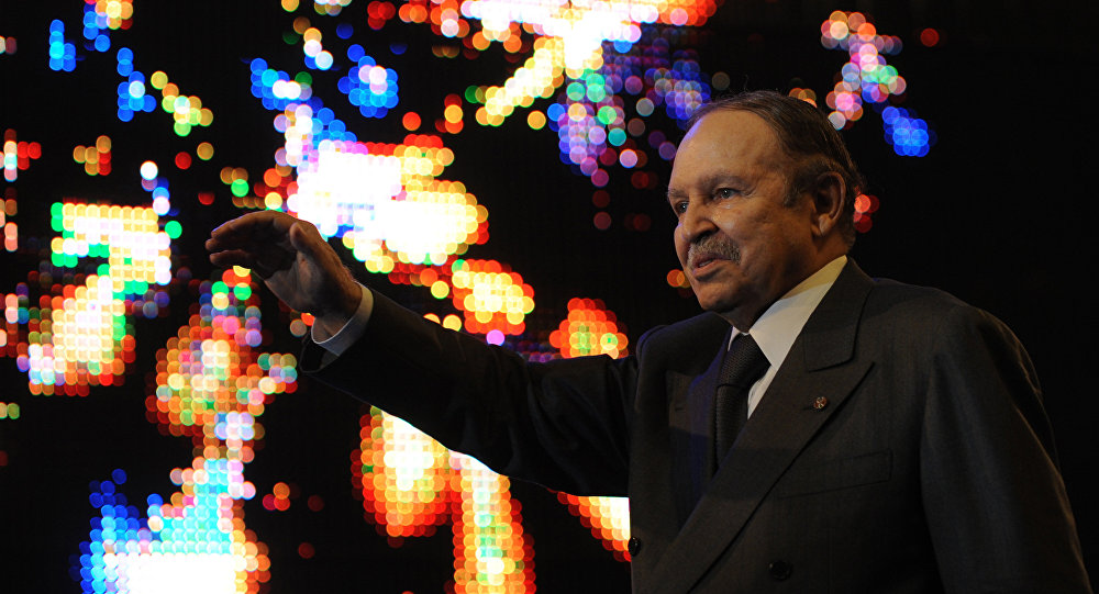 (FILES) In this file photo taken on February 12, 2009 Algerian President Abdelaziz Bouteflika waves to cheer his supporters during an election rally in Algiers.