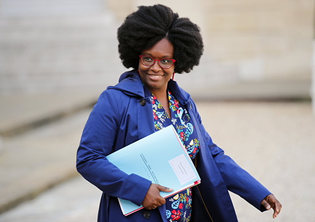 Sibeth Ndiaye, previously Macron's communication adviser, newly appointed spokeswoman of the government walks out after the weekly cabinet meeting at the ELysee Palace in Paris, Monday, April 1, 2019.