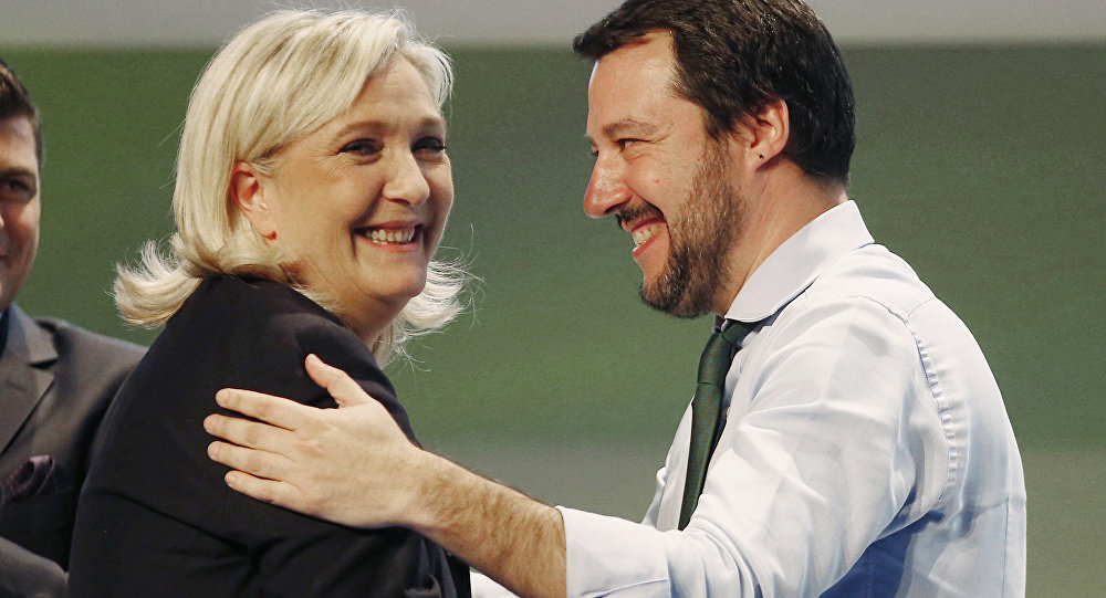 French National Front president Marine Le Pen, left, hugs Italy's Northern League leader Matteo Salvini during the Europe of Nations and Freedom movement meeting in Milan, Italy, Thursday, Jan. 28, 2016