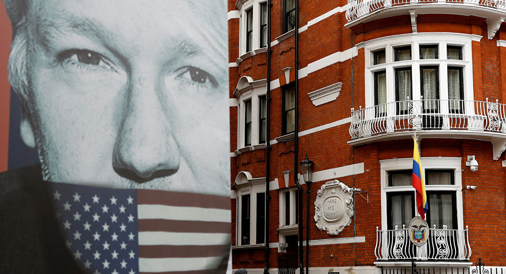 A truck carrying a poster relating to WikiLeaks founder Julian Assange is driven away from the Ecuadorian embassy, where Julian Assange is staying, in London, Britain April 5, 2019