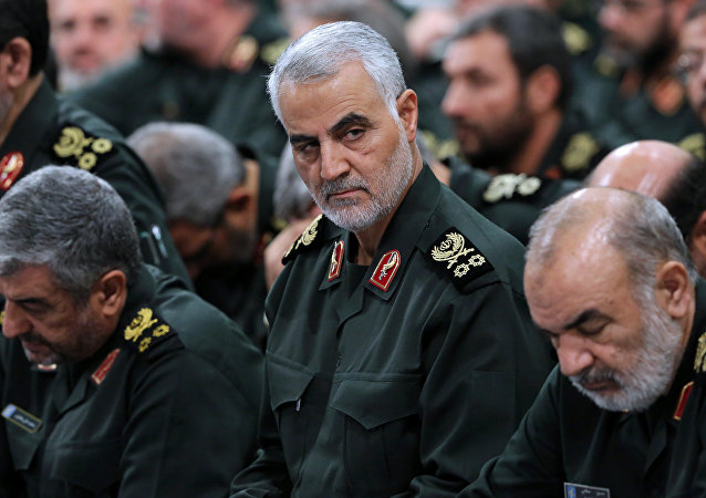 A handout picture released on September 18, 2016 by the official website of the Centre for Preserving and Publishing the Works of Iran's supreme leader Ayatollah Ali Khamenei shows the Quds Force commander Major General, Qassem Suleimani (C), attending a meeting of Revolutionary Guard's commanders in Tehran