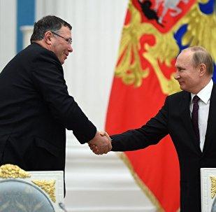 Vladimir Poutine avec le président de Total Patrick Pouyanné