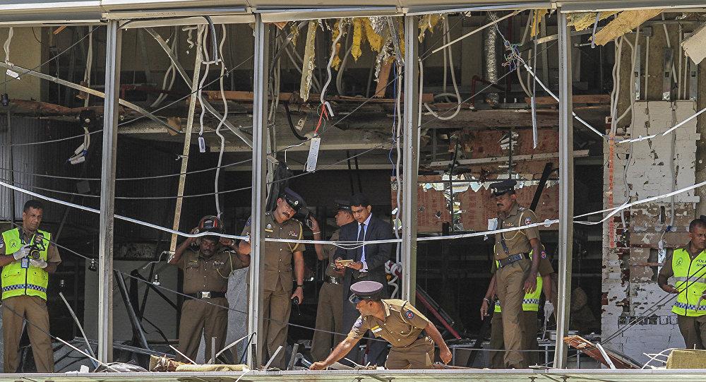 A Sri Lankan Police officer inspects a blast spot at the Shangri-la hotel in Colombo, Sri Lanka, Sunday, April 21, 2019.
