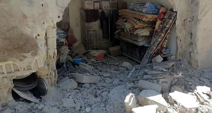 Une maison à al-Suqaylabiyya endommagée lors du pilonnage du 12 mai