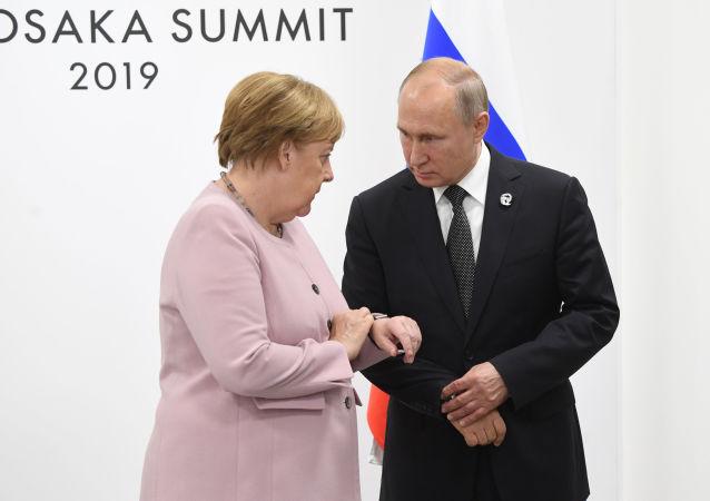 Angela Merkel et Vladimir Poutine à Osaka