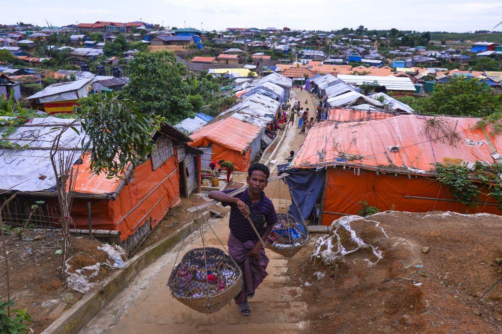 A Rohingya vendor walks around Kutupalong refugee camp on July 22, 2019.