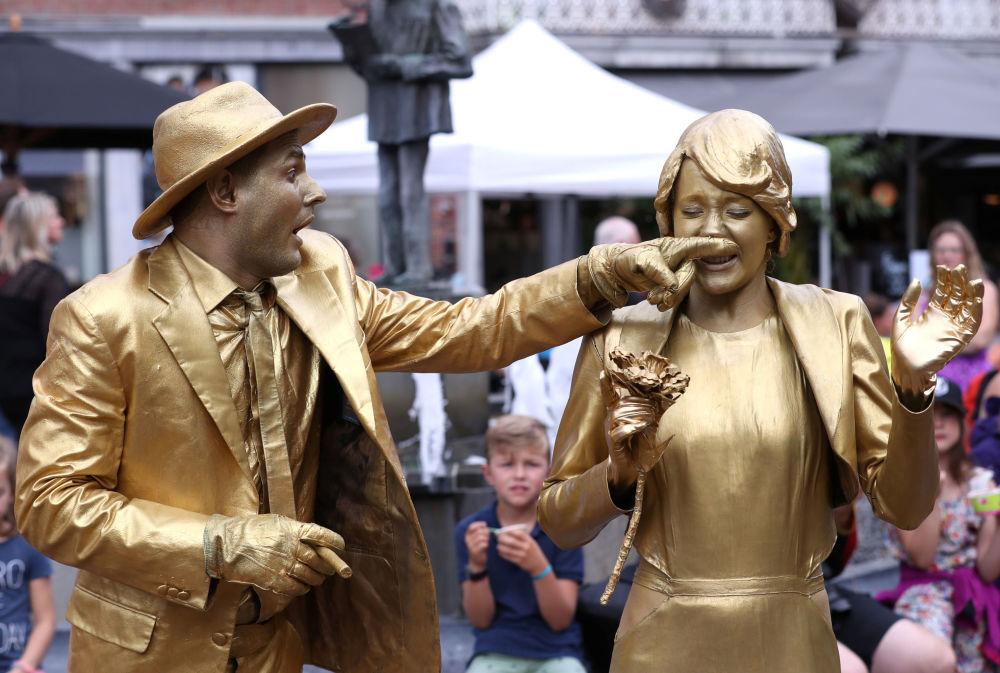 Artists called Golden Wedding take part in the festival Statues en Marche in Marche-en-Famenne, Belgium, July 20, 2019.