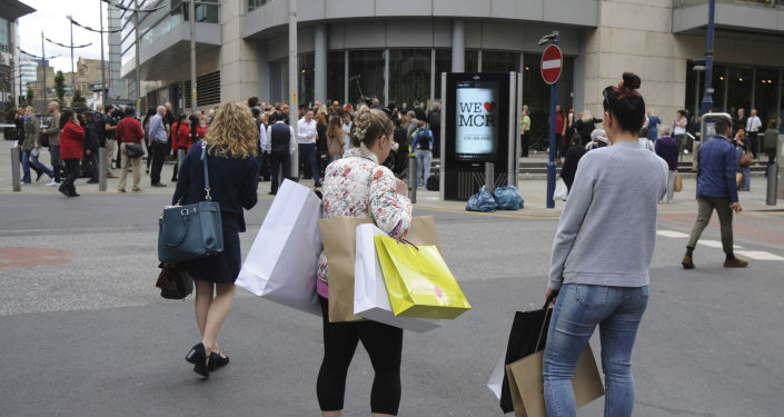 People stand outside as police evacuate the Arndale shopping centre, in Manchester, England Tuesday May 23, 2017