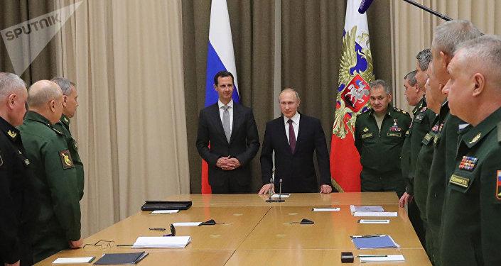 Une rencontre de Vladimir Poutine et Bachar el-Assad (archive photo)