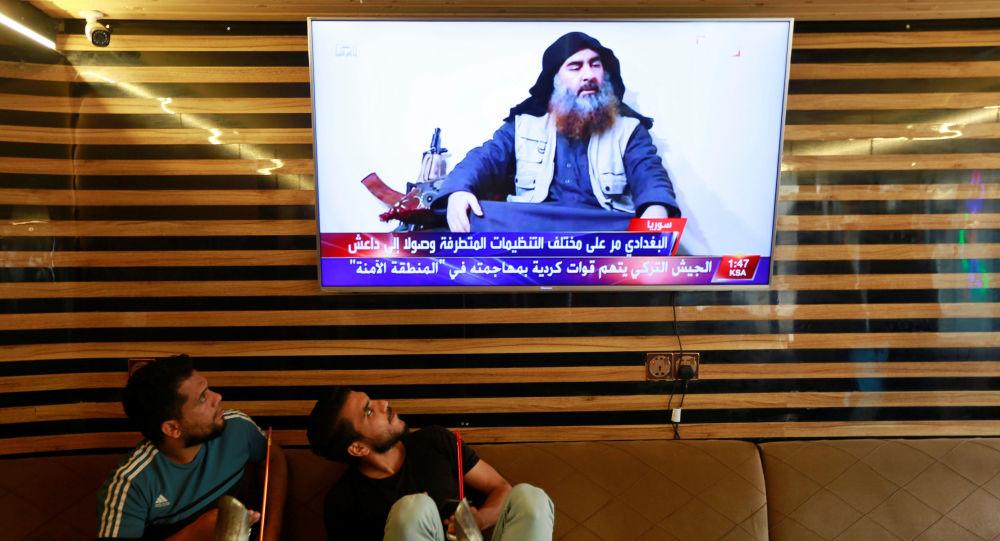 Iraqi youth watch the news of Islamic State leader Abu Bakr al-Baghdadi death, in Najaf, Iraq October 27, 2019.