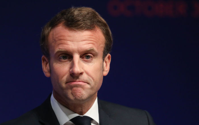 French President Emmanuel Macron reacts as he delivers a speech during the Global forum on Artificial Intelligence (AI) for Humanity (GFAIH) at the Institut de France on October 30, 2019, in Paris.