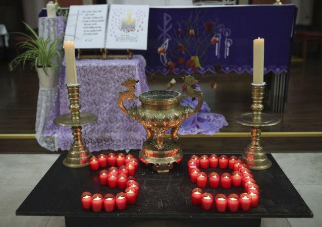 Des bougies installées de façon à créer le chiffre 39 pour rendre hommage aux victimes retrouvées dans un camion non loin de Londres
