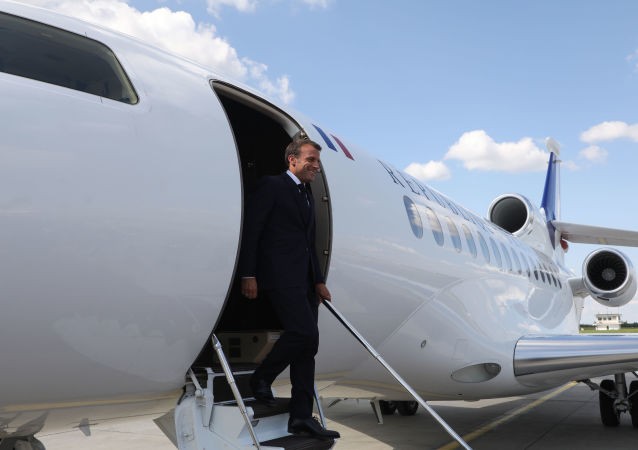 French President Emmanuel Macron leaves the aircraft upon arrival at the airport of Belgrade on July 15, 2019 for his two-day state visit. (Photo by ludovic MARIN / AFP)