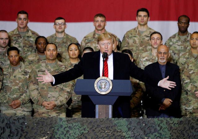 U.S. President Donald Trump delivers remarks to U.S. troops, with Afghanistan President Ashraf Ghani standing behind him, during an unannounced visit to Bagram Air Base, Afghanistan, November 28, 2019. REUTERS/Tom Brenner