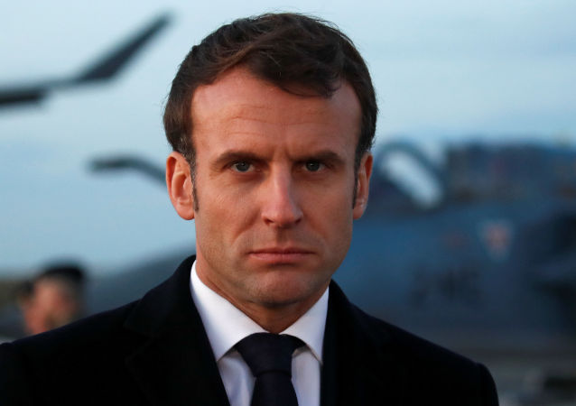 French President Emmanuel Macron visits a workshop at the Orleans – Bricy Air Base 123 in Boulay-les-Barres near Orleans, France, January 16, 2020.