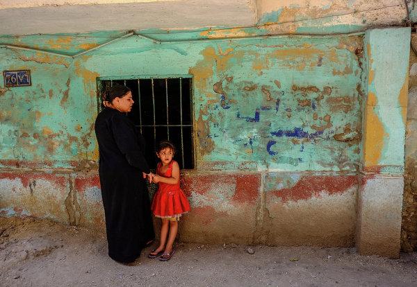 Коптская женщина с ребенком в Минье